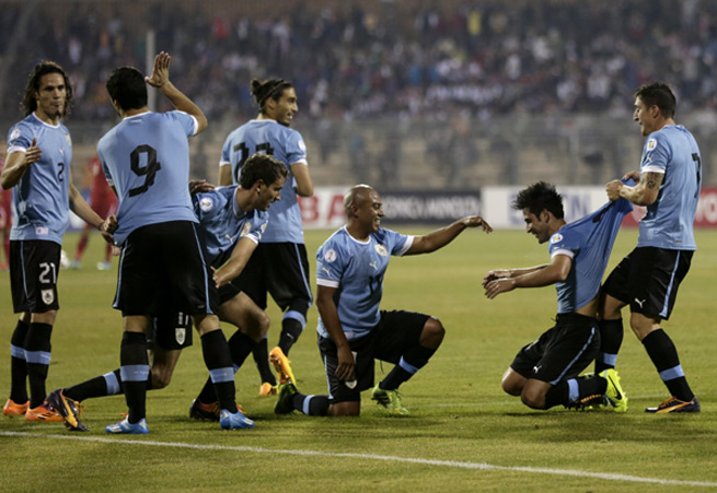 It was all fun and games for Uruguay, as the South American nation took a giant step toward the World Cup with a 5-0 victory over Jordan in the first leg of their qualifying playoff on Wednesday in Amman.