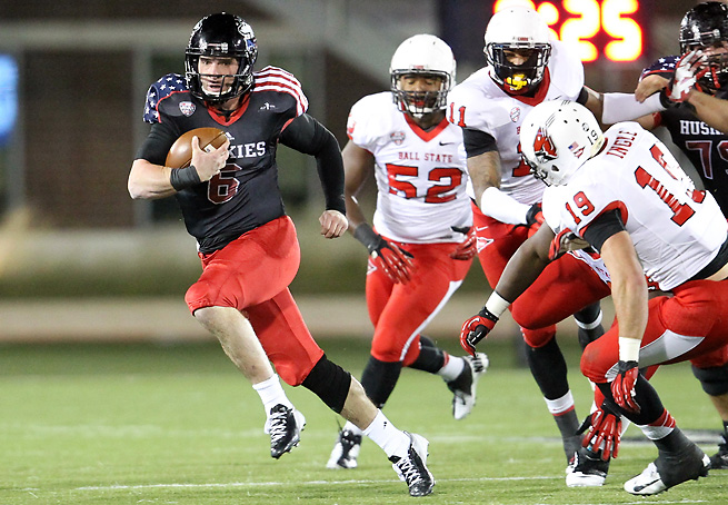 Jordan Lynch (6) combined for 468 yards of total offense and four TDs in NIU's victory over Ball State.