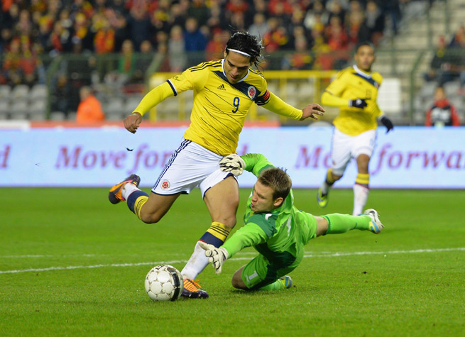 Colombia striker Radamel Falcao rounds Belgium goalkeeper Simon Mignolet as he scores the opening goal of Colombia's 2-0 friendly victory on Thursday in Brussels.
