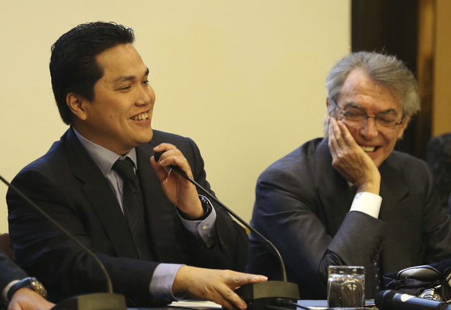 New Inter Milan owner Erick Thohir, left, is all smiles after replacing Massimo Moratti, right, as club president.