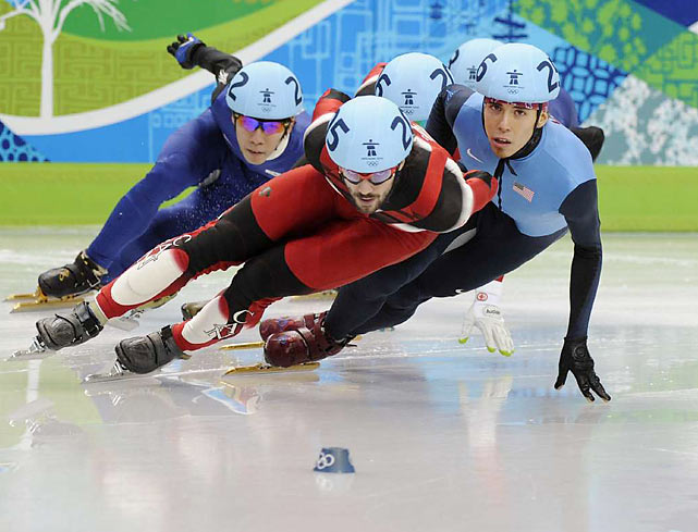 For 45 grueling and often frenetic laps, short track speedskaters from five teams take turns sizzling around the track, pulling unimaginable torque on a balancing rod no bigger than the width of a fingernail. When it goes wrong, skaters go sliding into restraining walls only to hustle back for more, because many races have more than one tumble and nobody is ever out of it.
