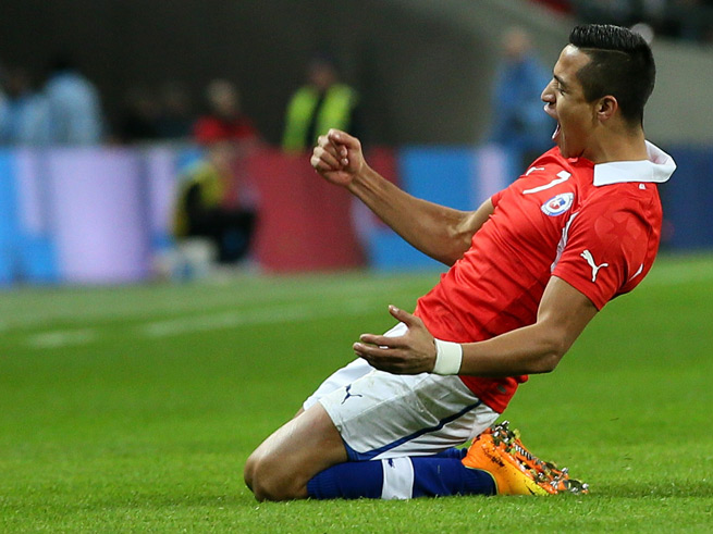 Chile forward Alexis Sanchez celebrates one of his two goals in his side's 2-0 win over England at Wembley Stadium Friday.
