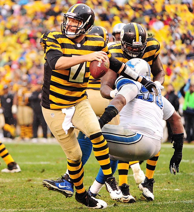 Steelers quarterback Ben Roethlisberger escapes pressure against the Lions. Pittsburgh's win kept it alive in the AFC playoff picture, as the Steelers moved to 4-6.
