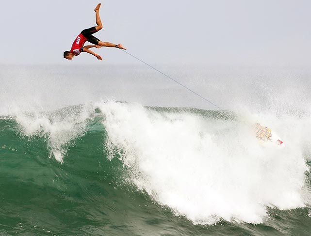 Maxime Huscenot of France flys over the top of the wave at the REEF Hawaiian Pro after deciding he had no scoring potential.