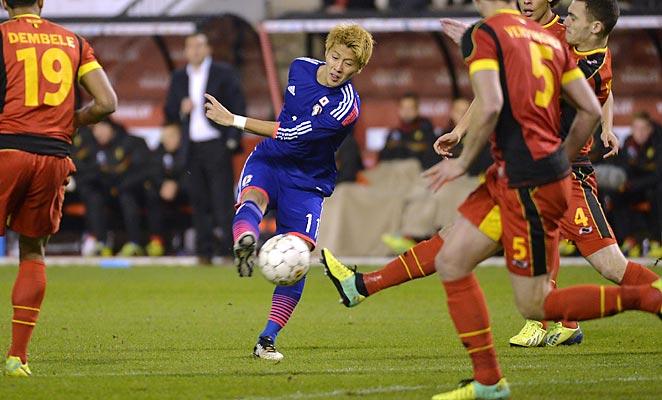 Yoichiro Kakitani scored Japan's first goal in a surprising win over Belgium.