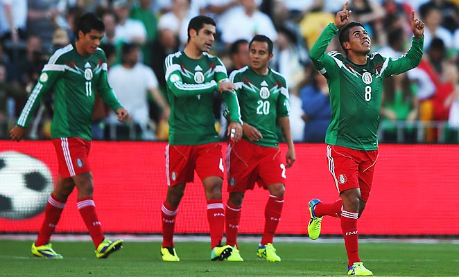 Juan Caros Medina scored as Mexico routed New Zealand to advance to the 2014 World Cup.