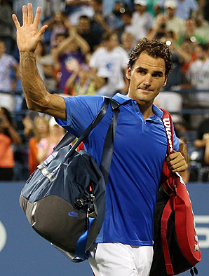 Roger Federer waves goodbye to the U.S. Open crowd after his surprising loss to Tommy Robredo in the fourth round.