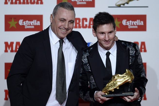 Lionel Messi, right, poses with former Barcelona and Bulgaria star Hristo Stoichkov after being presented with the Golden Boot for leading Europe's domestic leagues in goals last season.