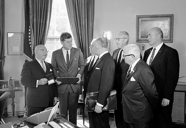 President John F. Kennedy receives a lifetime membership in the Amateur Athletic Union from AAU officials at the White House in Washington, D.C., on Nov. 30, 1961.
