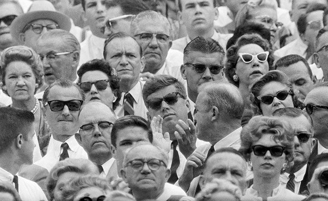President-elect John F. Kennedy applauds while sitting on the Navy side of the Orange Bowl near the 50-yard line during the Navy-Missouri football game on Jan. 2, 1961.