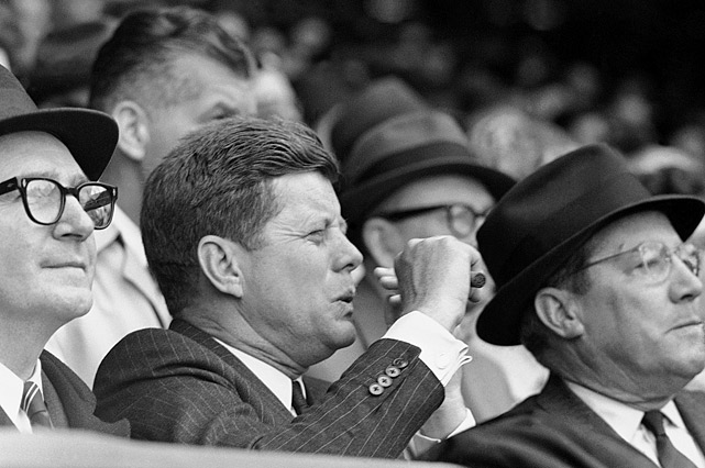 President John F. Kennedy reacts to a play during the opening day baseball game game between the Washington Senators and Chicago White Sox on April 10, 1961 at Griffith Stadium in Washington, D.C.