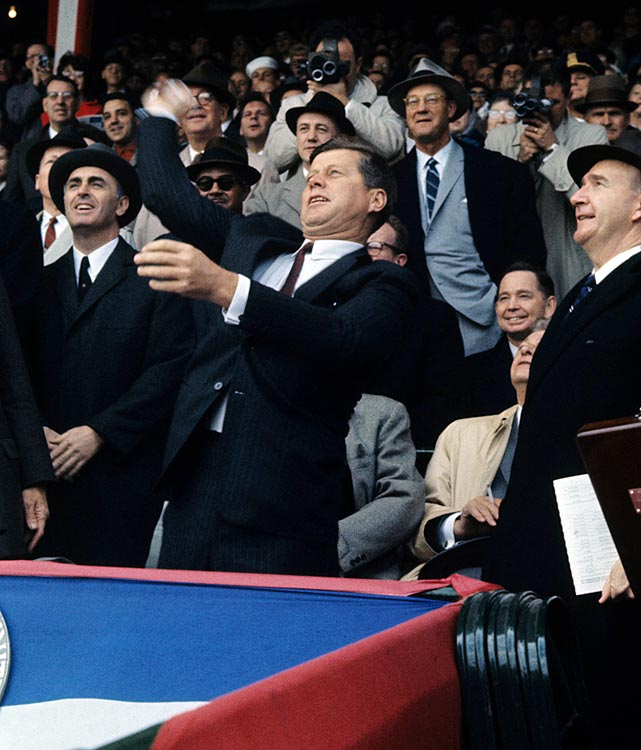 President John F. Kennedy throws out the first pitch at the opening day baseball game between the Washington Senators and Chicago White Sox on April 10, 1961 at Griffith Stadium in Washington, D.C.