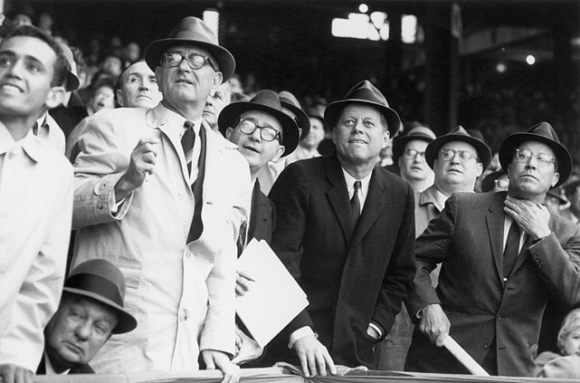 President John F. Kennedy and Vice President Lyndon Johnson watch a foul ball during the opening day baseball game game between the Washington Senators and Chicago White Sox on April 10, 1961 at Griffith Stadium in Washington, D.C.