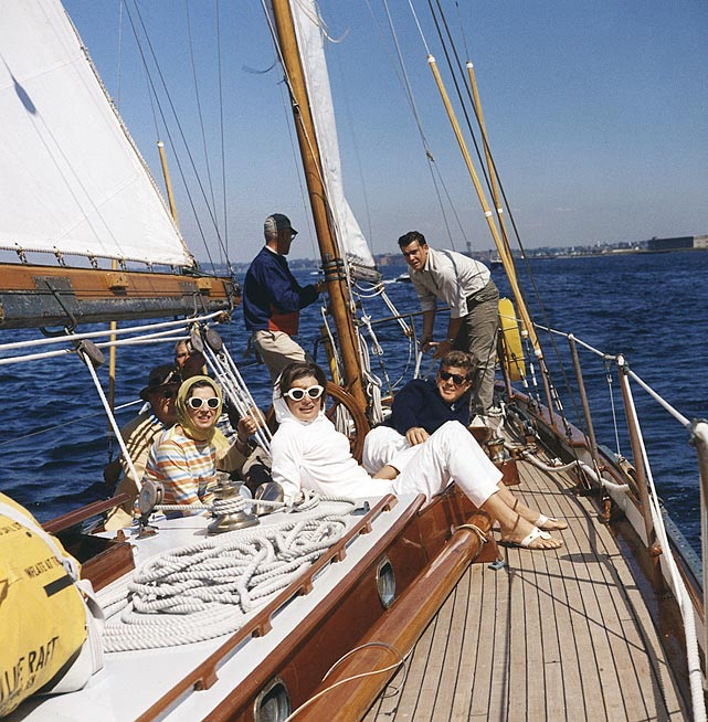 President John F. Kennedy and First Lady Jackie Kennedy attend the first of the 1962 America's Cup races on Sept. 9, 1962 off Newport, RI.