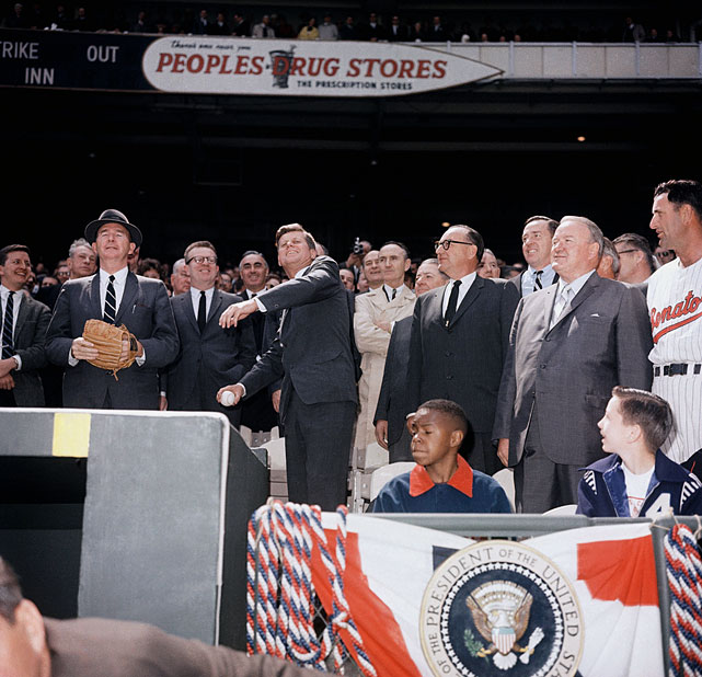 President John F. Kennedy throws out the first pitch at the opening day baseball game between the Washington Senators and Baltimore Orioles on April 8, 1963 at Griffith Stadium in Washington, D.C.