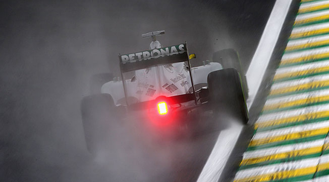 Nico Rosberg burned up the rainy Interlagos track in the afternoon after topping the morning session.