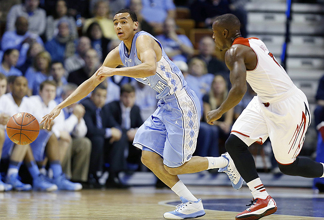 Paige, left, nearly matched All-American guard Russ Smith in points to lift UNC in the upset.