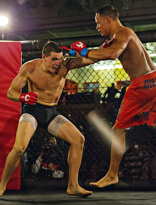 Bernardo Cano (black trunks) grapples with Oswald Diaz. Cano won by submission in the second round.