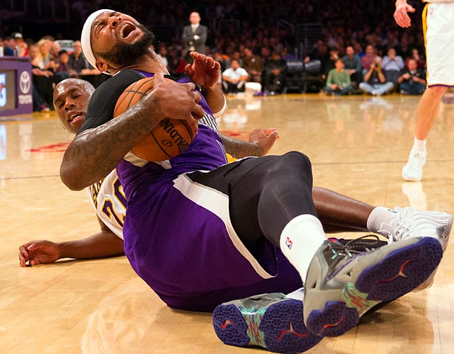 Kings forward DeMarcus Cousins wrestles a loose ball away from Lakers guard Jodie Meeks.