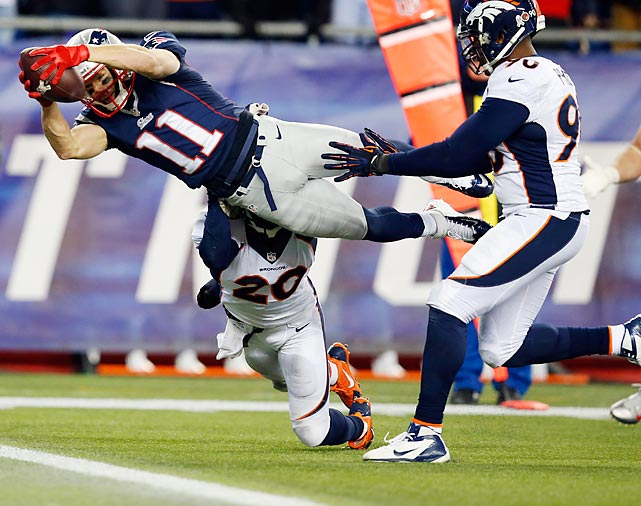 Patriots wide receiver Julian Edelman lunges for a touchdown against the Broncos. New England came back from a 24-0 halftime deficit to stun Denver in overtime 34-31.