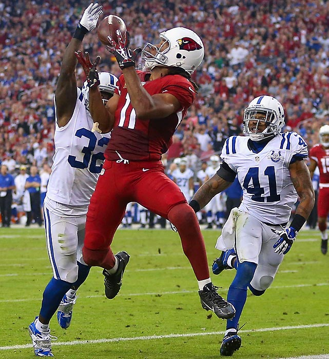 Cardinals wide receiver Larry Fitzgerald catches a touchdown pass against the Colts. In the game, Fitzgerald became the youngest player to reach 11,000 yards receiving.