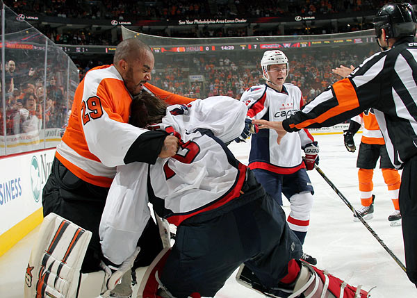 "With the NHL pondering harsher penalties for fighting, the Flyers' hotheaded goalie picked a bad time to go psycho. When a scrap broke out during the third period of a 7-0 whupping by Washington, Emery left his crease to pummel counterpart Braden Holtby, who clearly wanted no part of a fight. What ensued was a one-sided crazy man beatdown that led NHL discipline czar Brandon Shanahan to wish he could suspend Emery, but no such rule existed. Commissioner Gary Bettman was moved to approach Emery and say, ""So just hypothetically, if there was a rule that said if you cross the red line to get into a fight with the other goaltender and you get a 10-game suspension, would you have done it?"" Emery's response: ""What? Are you crazy?""'"