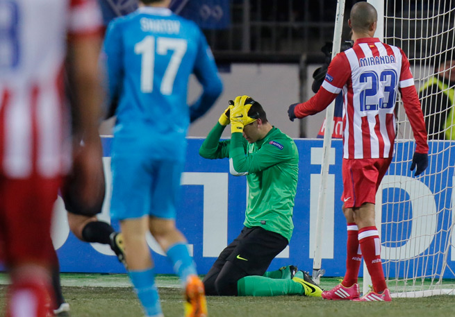 Atletico Madrid goalkeeper Thibaut Courtois reacts after Toby Alderweireld's own goal forced his side to settle for a 1-1 draw with Zenit in the Champions League.