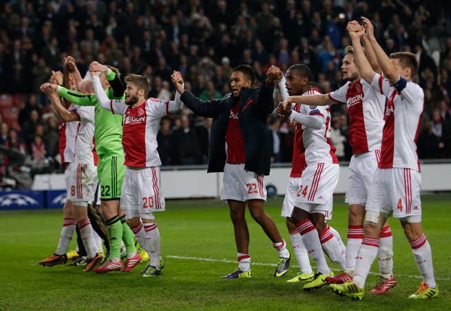 Ajax celebrates its 2-1 victory over Barcelona, which keeps the club's Champions League knockout stage hopes alive.