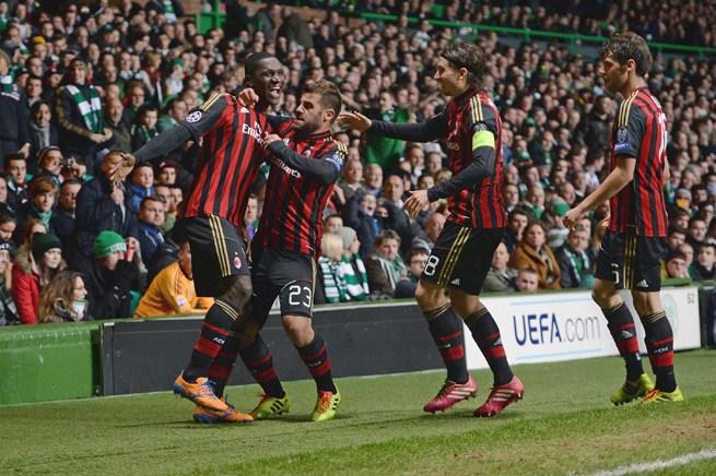 Cristian Zapata, left, celebrates his goal in AC Milan's Champions League rout of Celtic on Tuesday.