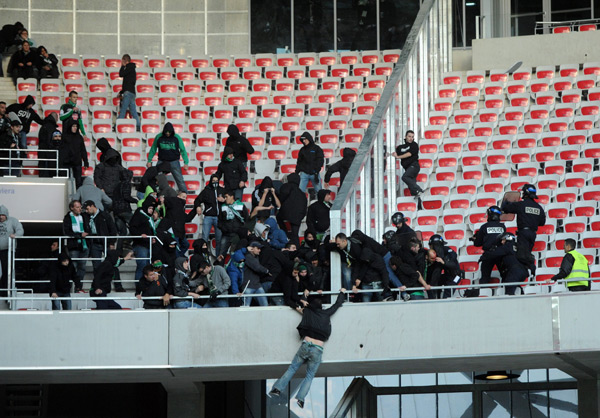 Unruly Saint-Etienne fans threw seats at Nice supporters and clashed with police last weekend, resulting in them being banned from away games for the rest of 2013.