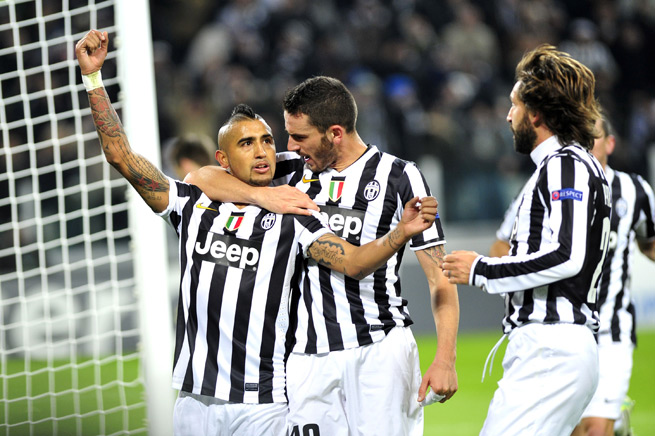 Arturo VIdal, left, celebrates scoring a goal as part of his hat trick in Juventus' Champions League win over Copenhagen.