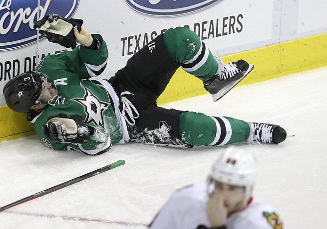 Stephane Robidas was injured when he fell awkwardly into the boards in the Stars' zone.