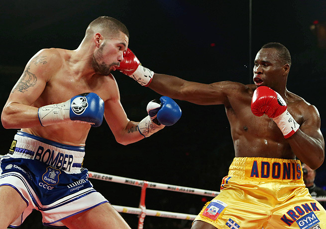 Adonis Stevenson (right) took out Tony Bellew in retaining his WBC light heavyweight title.