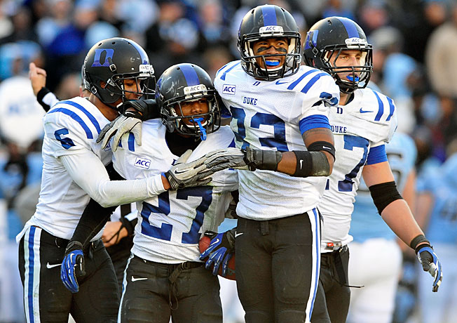 Duke's DeVon Edwards (27) picked off Marquise Williams in the final seconds to secure a win over UNC.
