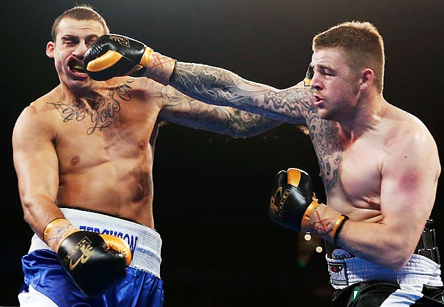 Luke Turner lands a right to the face of Blake Ferguson during their heavyweight bout on Nov. 27 in Sydney Australia. Ferguson, a former rugby player, lost his boxing debut by unanimous decision, losing every round but the first.