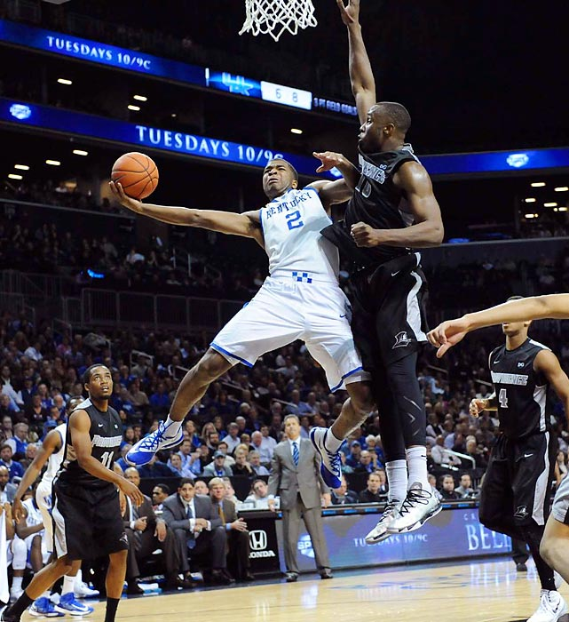 Kentucky guard Aaron Harrison goes up for a layup against a Providence player during the school's non-conference matchup Sunday. Harrison's 15 points on 7-of-9 shooting helped the No. 3 Wildcats race past the Friars 79-65.