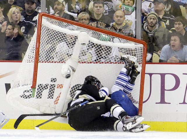 Pittsburgh Penguins defenseman Simon Despres and Toronto Maple Leafs center Trevor Smith crash into the goal during the second period of their Nov. 27 game. Two third-period goals rescued the Penguins from a 5-4 deficit for a 6-5 victory in Pittsburgh.