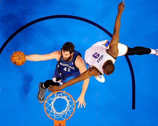 Minnesota Timberwolves power forward Kevin Love maneuvers around Oklahoma City Thunder power forward Serge Ibaka during a Sunday game. Love had a double-doube, scoring 16 points with 12 rebounds, but made just 4-of-14 shots in the Thunder's 113-103 home win.