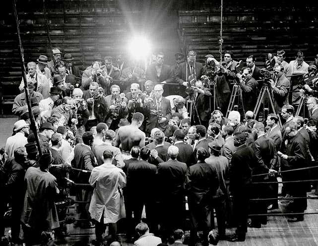 Leifer, thinking outside the box?and outside the ring?captured the crowd of cameras surrounding Ali, as the champion weighed in for his fight against Zora Folley at Madison Square Garden in March 1967. Click here for Neil Leifer's fine art photography.
