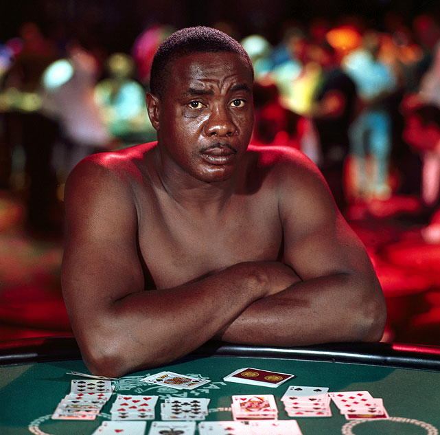 Cashed out: This photo of Liston posed at a poker table in Caesars Palace in Las Vegas on May 25, 1967 offers a haunting portrait of the former champion, then on the comeback trail. He would never get another shot at the title, dying under mysterious circumstances at his Las Vegas home on Dec. 30, 1970. Click here for Neil Leifer's fine art photography.