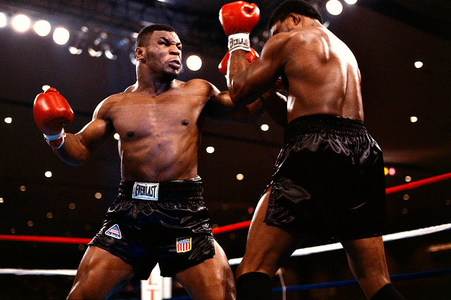 Boxing was re-energized in the 1980's by the emergence of the seemingly unstoppable Tyson, who tore through the heavweight ranks with a fearsome blend of speed and power. Here, he unloads on WBC champion Berbick at the Las Vegas Hilton on Nov. 11, 1986. Tyson would end the bout with a stunning 2nd round TKO to become the youngest heavyweight champion in history. Click here for Neil Leifer's fine art photography.