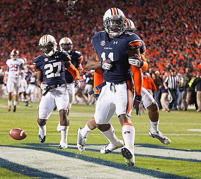 Auburn cornerback Chris Davis celebrates in the end zone with teammates after winning the Iron Bowl 34-28 on the final play of the game. The Tigers redeemed themselves against rival Alabama after an embarrassing 49-0 defeat in last year's Iron Bowl.
