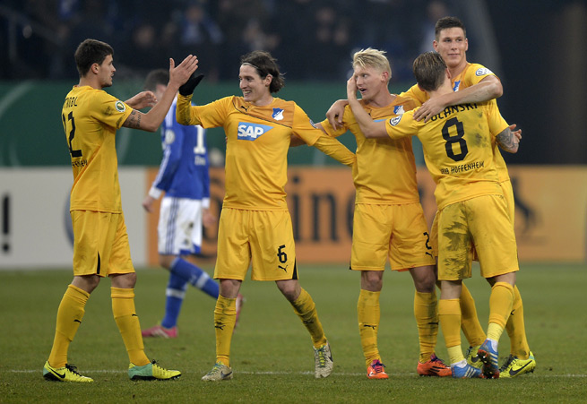 Hoffenheim players celebrate their victory over Schalke to advance to the quarterfinals of the German Cup Tuesday.