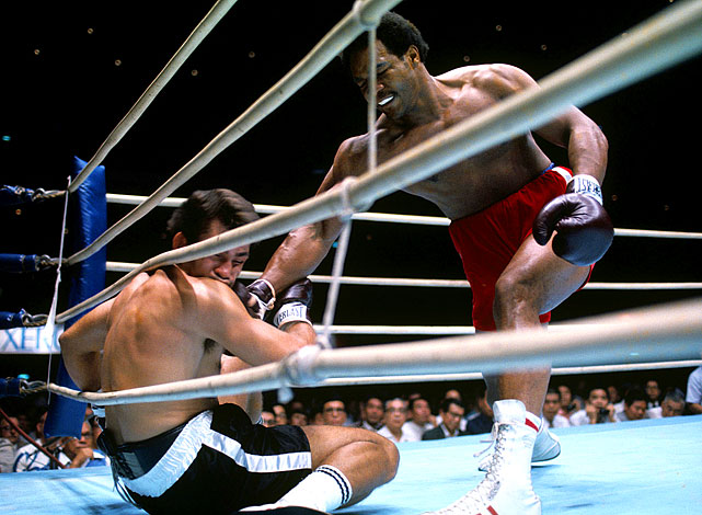 Big George at his bruising best: In his first defense of the heavyweight title, Foreman blasted the hapless Roman to the canvas three times in the opening round of their bout in Tokyo. The fight was over after just two minutes, and Foreman's reputation as a destroyer grew. Click here for Neil Leifer's fine art photography.