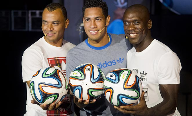 Former Brazilian star Cafu, Hernanes, and Clarence Seedorf present the new ball that will be used in next year's World Cup.
