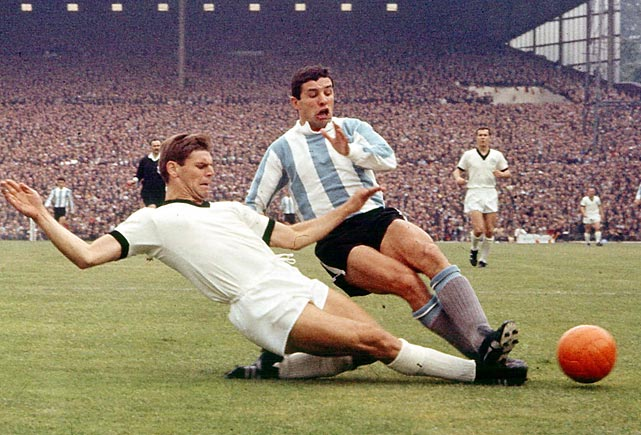 West Germany's Wofgang Weber and Argentine Jorge Solari both go for the ball during their Group Two match.