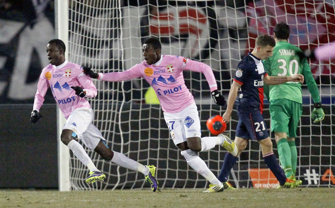 Modou Sougou (L) and teammate Clarck N'Sikulu (2nd L) of Evian Thonon Gaillard celebrate after scoring against PSG in a surprise 2-0 victory.