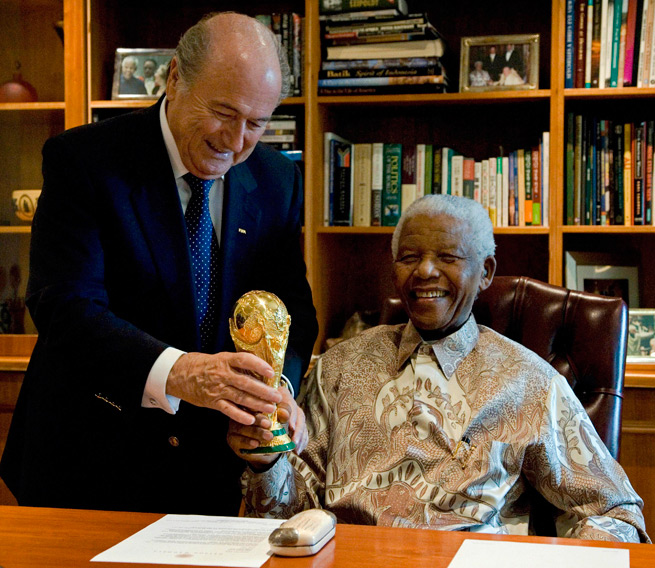 Sepp Blatter presents the late Nelson Mandela the World Cup trophy in South Africa during a meeting in 2008.