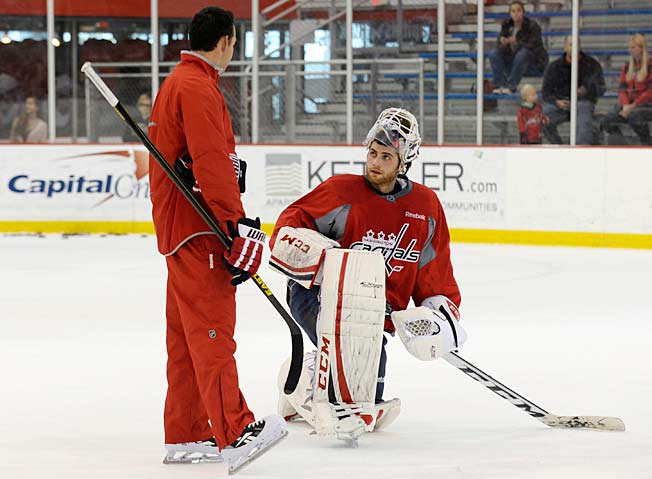 Capitals goaltending coach Olaf Kolzig (left) has been preaching patience to Braden Hotlby.
