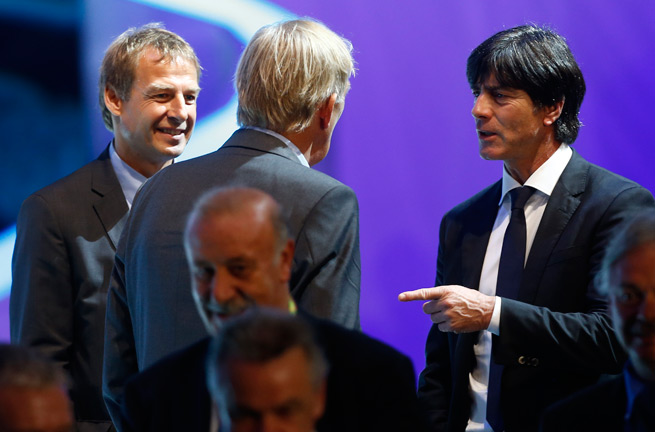 USA manager Jurgen Klinsmann, left, and Germany manager Joachim Low, right speak to Cameroon coach Volker Finke at Friday's World Cup draw.